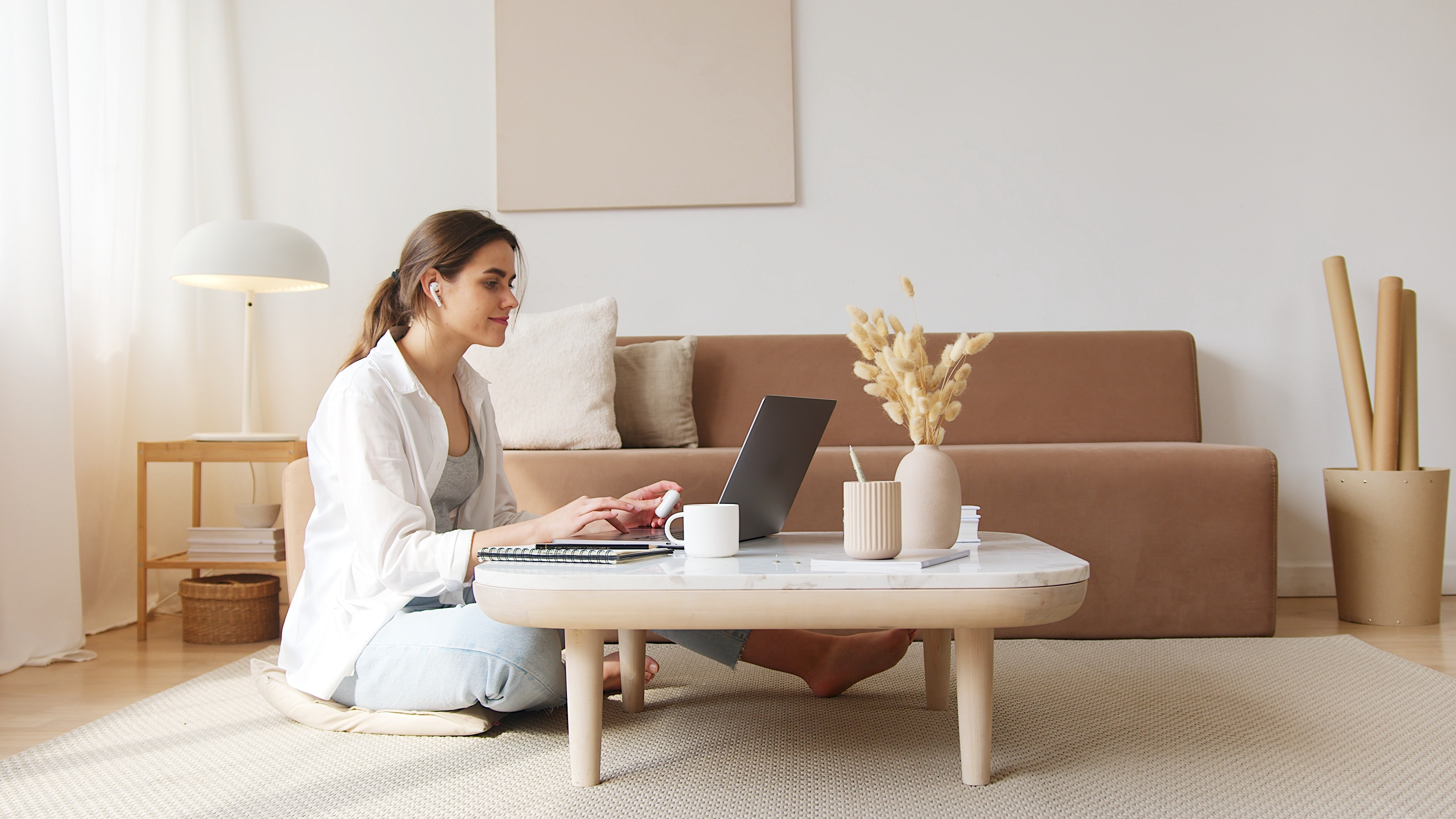 content-woman-using-laptop-on-floor-4492129